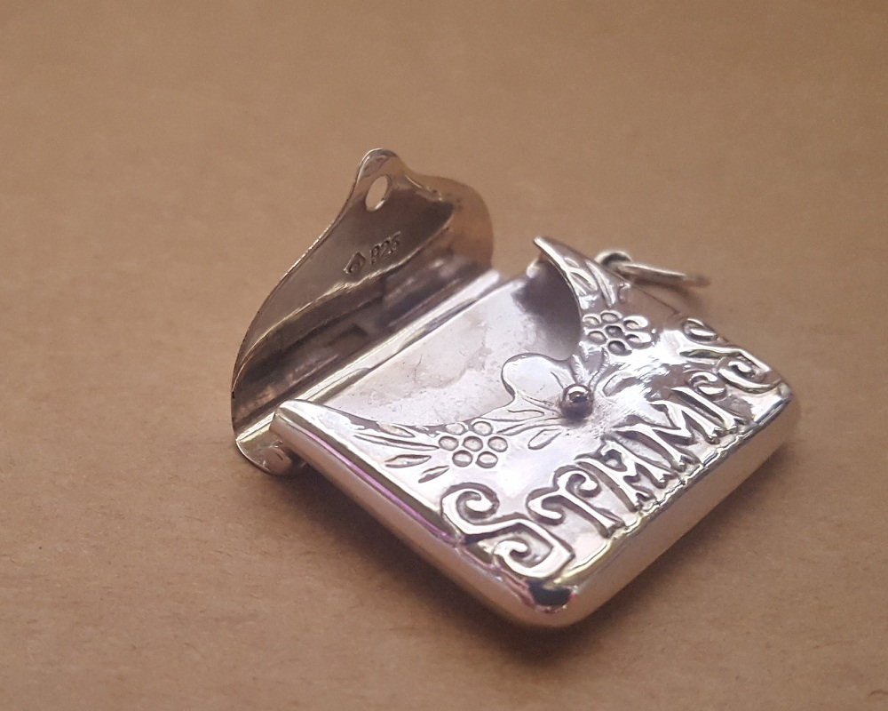 silver antique locket stamp case