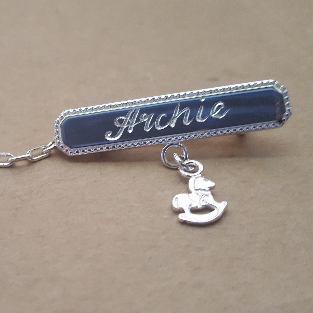 engraved baby brooch with charm