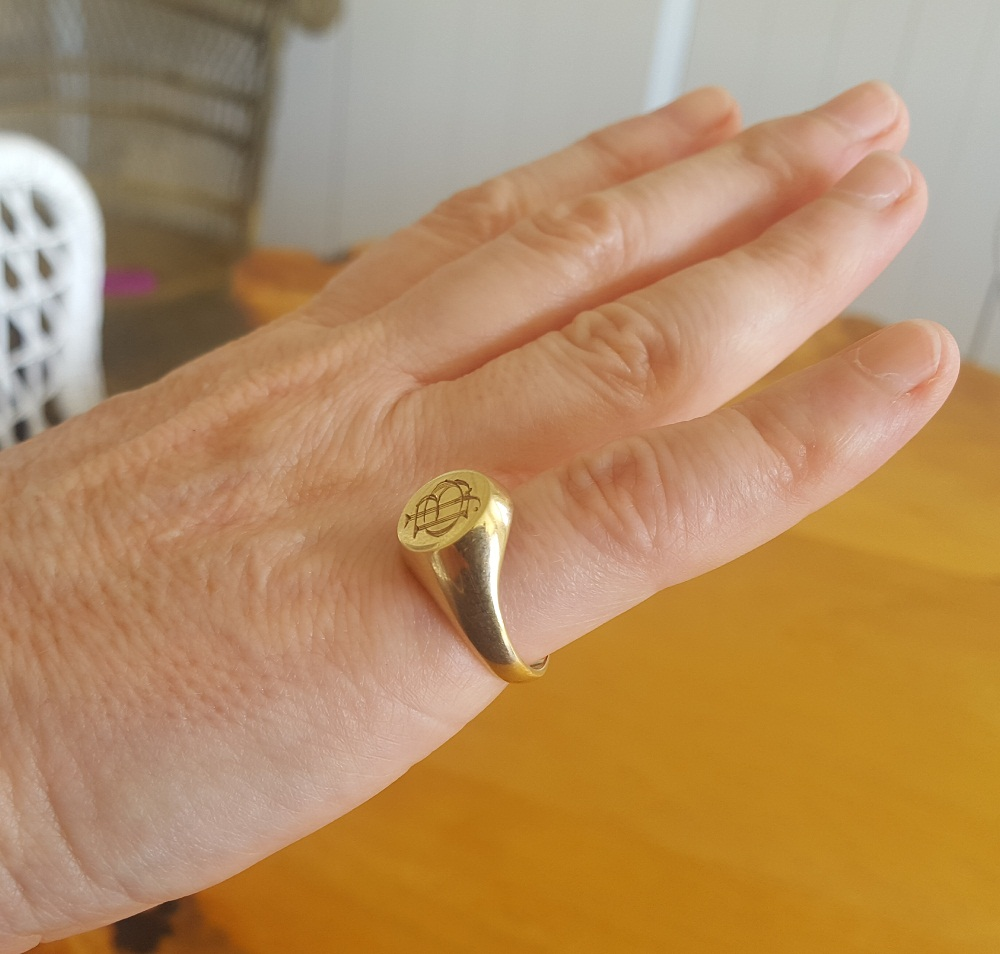 large signet ring small hand