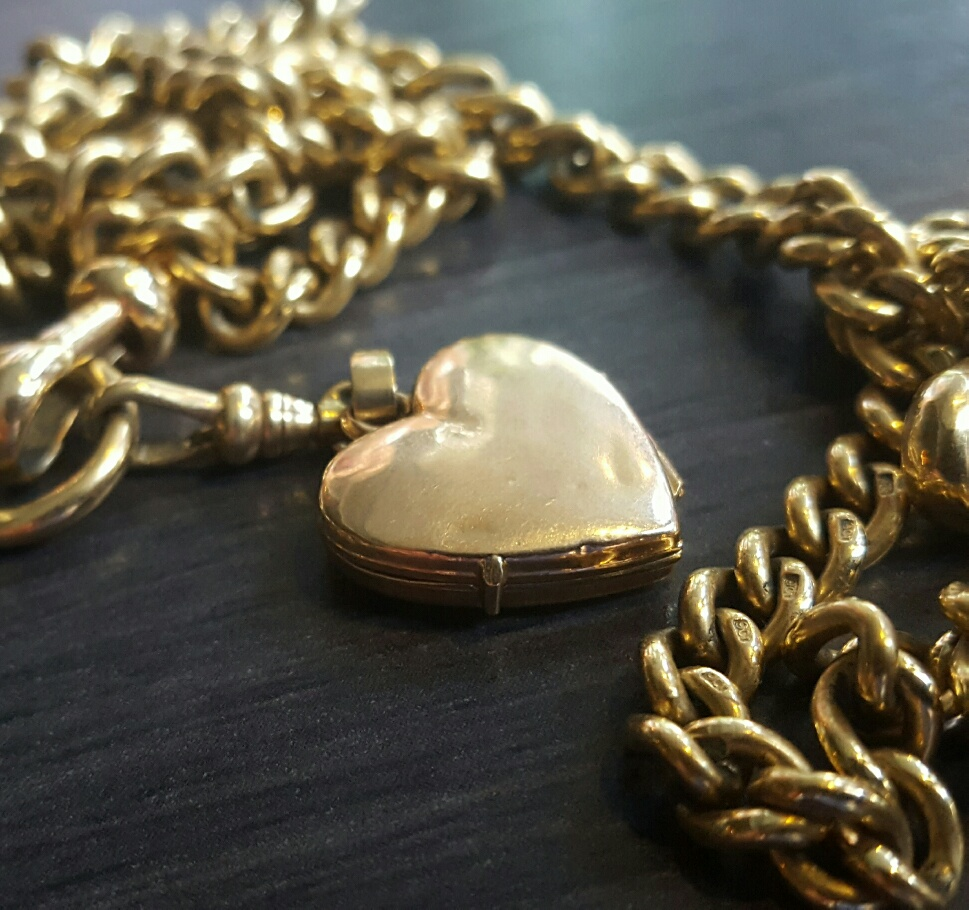 old gold locket and chain