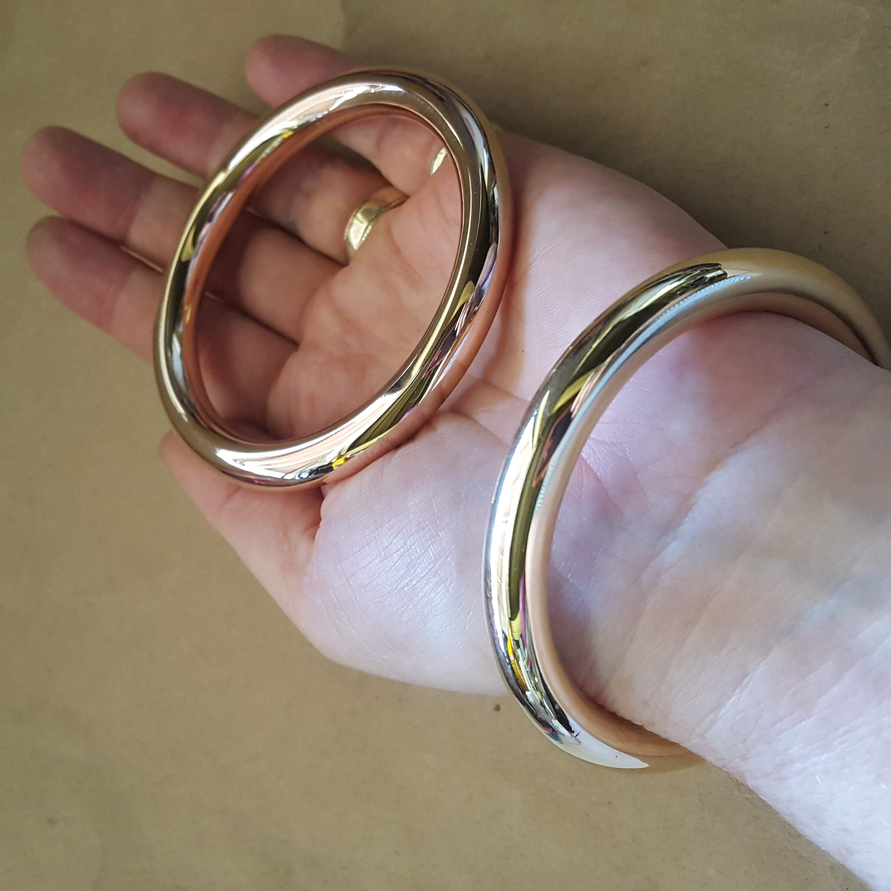 gold bangles in hand