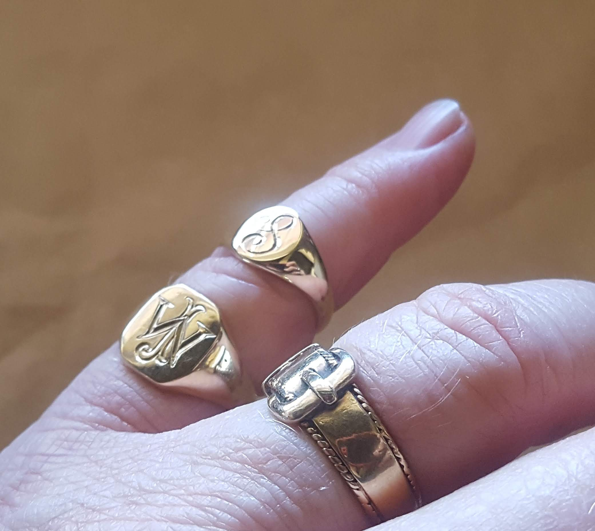 gold signet rings on finger